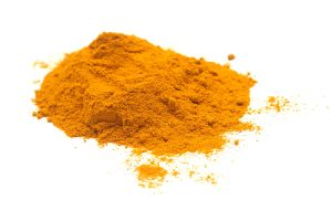 Turmeric powder food ingredient in white background
